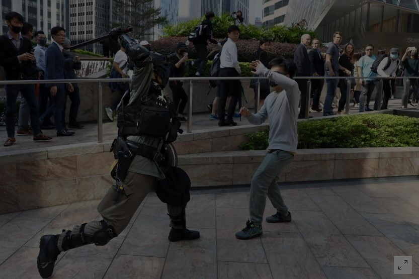Hong Kong anti-government protesters paralyzed parts of the Asian financial hub for a third day, with some transport links, schools and many businesses closing after an escalation of violence.