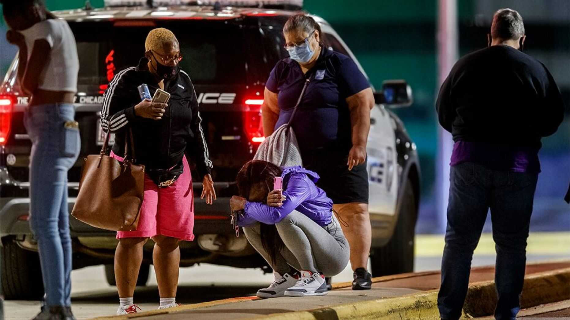 A woman kneels on the ground outside the University of Chicago Medicine's Comer Children's Hospital where an 8-year-old girl was taken after being killed in a shooting during the Labor Day weekend Monday, Sep. 7, 2020, in Chicago. (Armando L. Sanchez/Chicago Tribune/Tribune News Service via Getty Images)