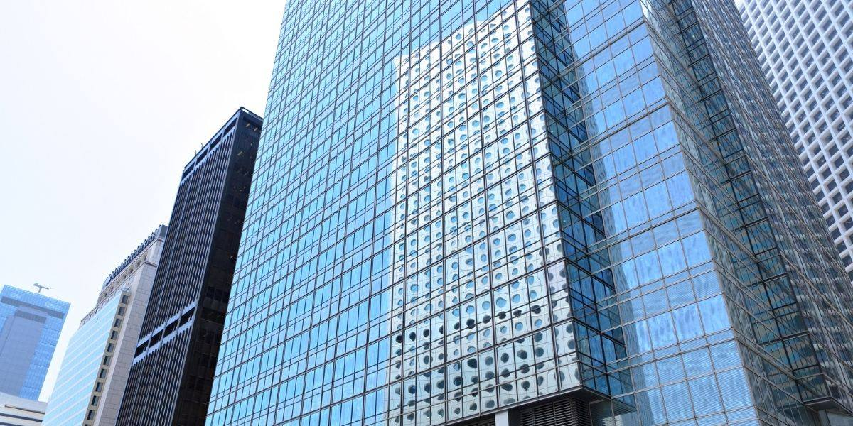 Why are office buildings made of glass