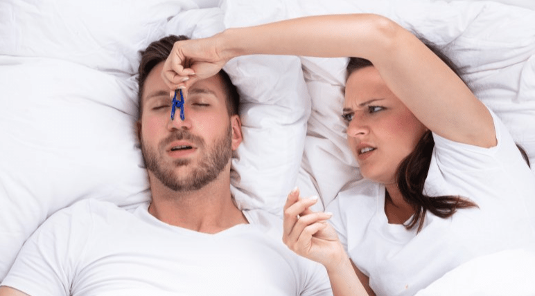 Tips For Sleeping With Someone Who Snores