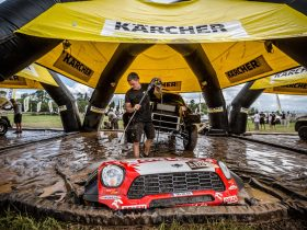 Why is it advisable to use a gas pressure washer for cleaning your car after a race?